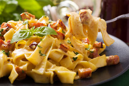 eggs and bacon: Pasta Carbonara with bacon, basil and cheese