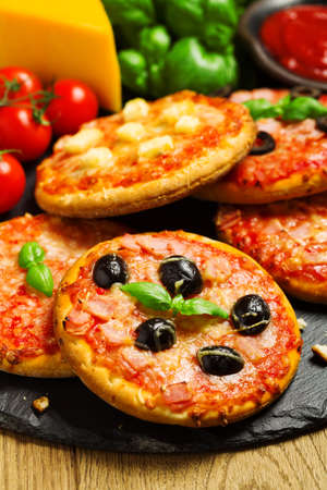 mini pizza: Mix of mini pizzas on a stone try