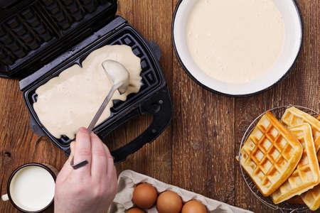 Baking waffles at home.