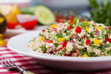 TABBOULEH Salad with cous cous and vegetable. Lebanese delicacy. Zdjęcie Seryjne - 52538460
