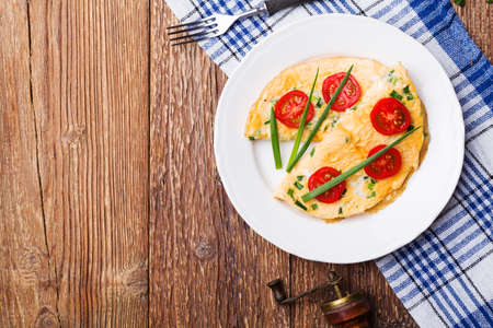 an omelette: Delicious omelette with vegetables