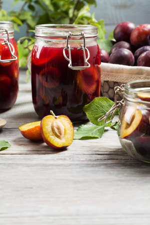 compote: Homemade plum compote on wooden board