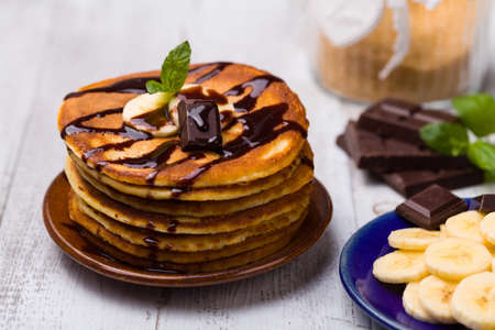 Delicious pancakes with bananas and chocolate. 스톡 콘텐츠