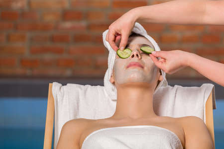 nourishing: Applying nourishing mask on the face, in the SPA.