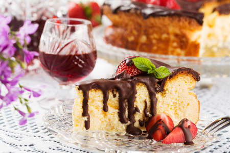 drenched: Homemade cheesecake with strawberries drenched in chocolate, served with alcohol.