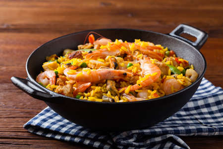 Traditional Spanish paella with seafood and chicken. Prepared in wook.