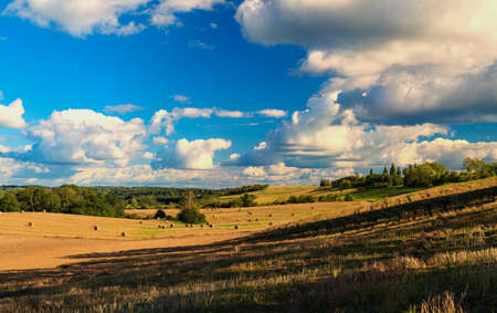 Beautiful landscape with snopkami straw on the field. Masuria - Poland Stock Photo