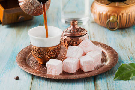 Traditionally brewed Turkish coffee. Specified in the original containers with Turkish delight.