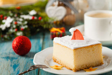 Delicious, traditional cheesecake. Christmas decoration. Front view.