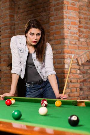 cue sticks: Woman playing billiards Stock Photo