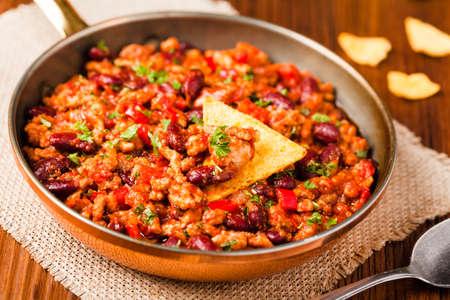 con: Mexican nachos with chili con carne. Front view.
