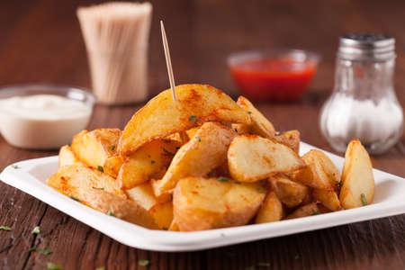 bravo: Traditional Spanish baked potato with hot pepper chili. Bravas dip. Front view