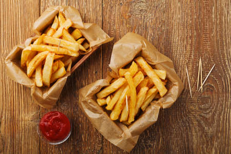Serving Belgian fries served in a paper box. With or without a dip.
