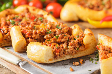Turkish pide pizza with meat and cheese, home made. Front view. Stock Photo