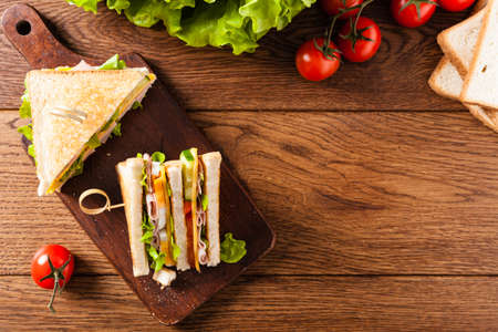 Delicious toast sandwich with ham, cheese, egg and vegetables. Top view.