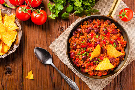 Mexican nachos with chili con carne. Top view. Stock Photo