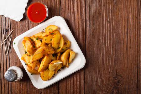 bravo: Traditional Spanish baked potato with hot pepper chili. Bravas dip. Top view Stock Photo
