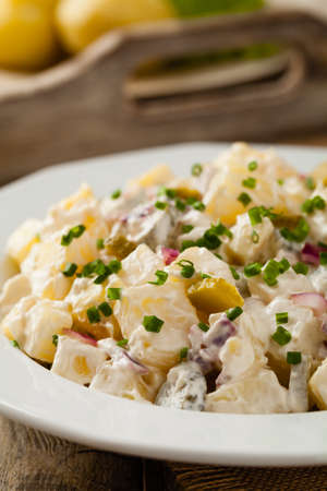 Traditional German potato salad with cucumber, onion and mayonnaise.