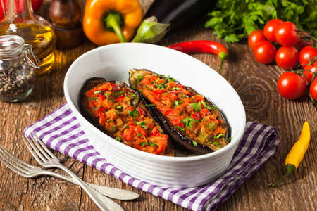 Stuffed aubergine. Wooden background. Front view. Фото со стока