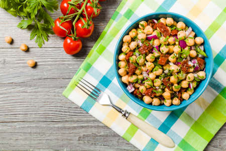 Chickpeas salad with onion and dried tomatoes. Top view.