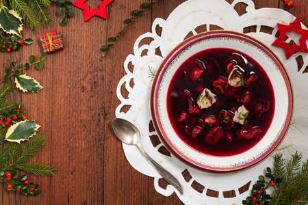 Traditional, Polish Christmas red borsch with dumplings. Top view.