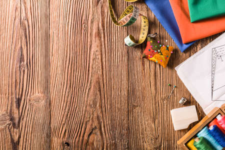 Tailor accessories. Concept. Natural wooden background. View from above.