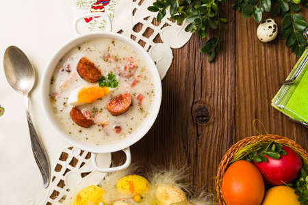 Traditional Polish white borsch with Easter decoration. Top view Stock Photo
