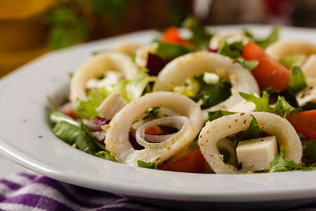 Salad with squid rings. Front view.