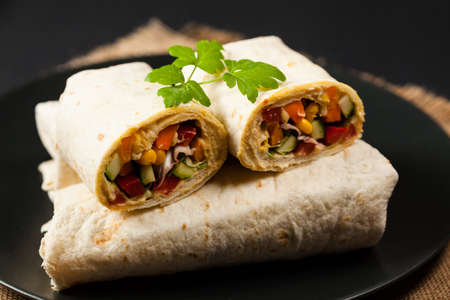 Tortilla with vegetables and hummus with chickpeas. Front view. Banco de Imagens
