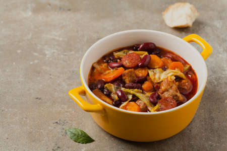 Traditional portuguese goulash with cabbage, beans and ribs. Front view. Stone background.