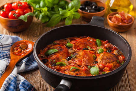 Traditionally made chicken in tomato sauce cacciatore. Front view. Stock Photo