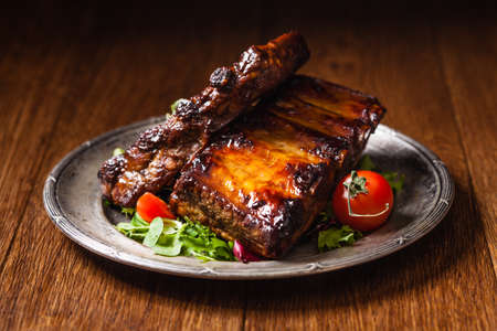 Roasted ribs  served on an old plate.