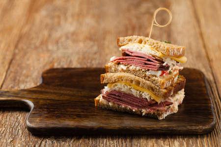 Reuben sandwich. New York sandwich with pastrami, thousand island sauce and sauerkraut. Front view. Fast food.