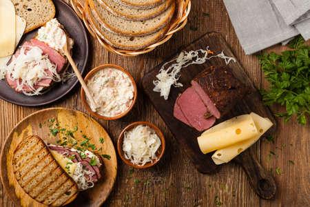 Reuben sandwich. New York sandwich with pastrami, thousand island sauce and sauerkraut. Top view. Fast food.