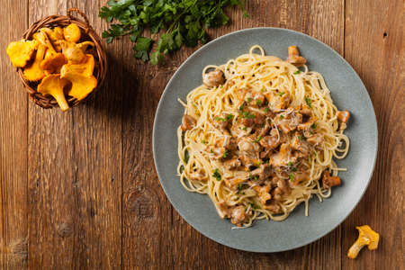 Spaghetti with mushroom chanterelles. Top view.