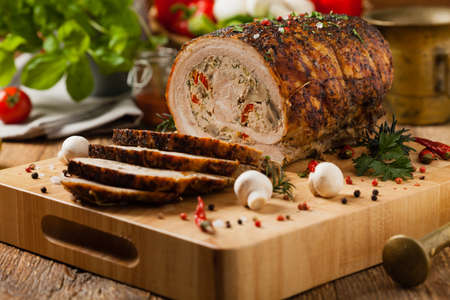Baked whole bacon. Roulade with minced meat, mushrooms and paprika. Front view. Banco de Imagens