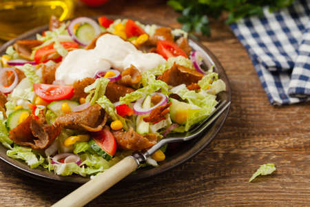Gyros, kebeb. Salad with mutton and vegetables. Front view. Imagens