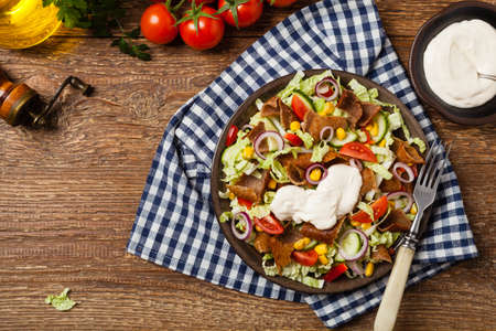 Gyros, kebeb. Salad with mutton and vegetables. Top view. Imagens