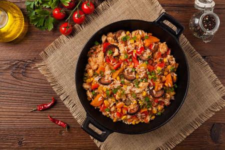 Traditional jambalaya perepared in wok, serwed on plate. Top view.