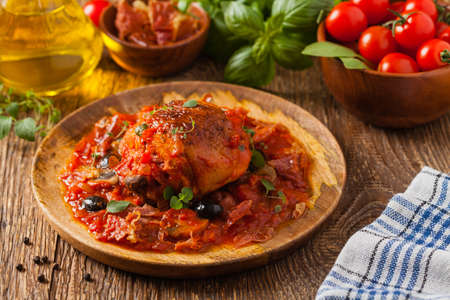 Traditionally made chicken in tomato sauce cacciatore. Front view. Stok Fotoğraf