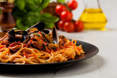 Spaghetti with mussels. Front view.