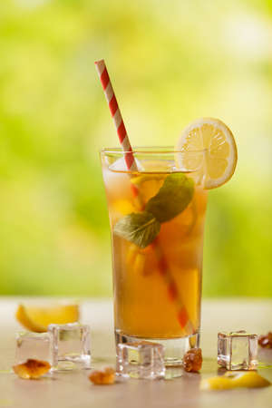 Iced tea with lemon and ice cubes.