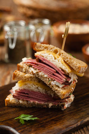 Ruben sandwich. New York sandwich with pastrami, sauce thousand islands and sauerkraut. Front view. Fast food.