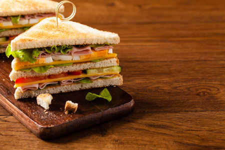 Delicious toast sandwich with ham, cheese, egg and vegetables. Front view.
