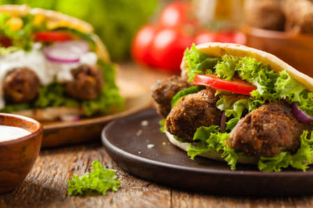 Kebab, kofta in pita, bun. Traditional southern European dish. Front view.