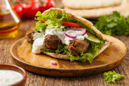 Kebab, kofta in pita, bun. Traditional southern European dish. Front view.