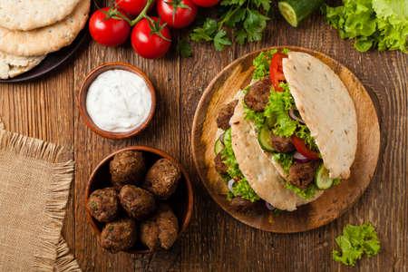 Kebab, kofta in pita, bun. Traditional southern European dish. Top view.