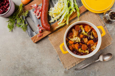 Traditional portuguese goulash with cabbage, beans and ribs. Top view. Stone background.