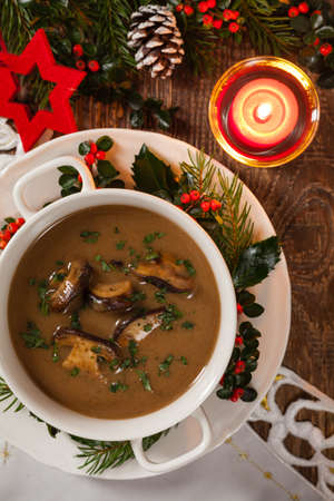 Traditional mushroom soup, made from porcini mushrooms. Christmas decoration. Top view. Stok Fotoğraf - 130073694