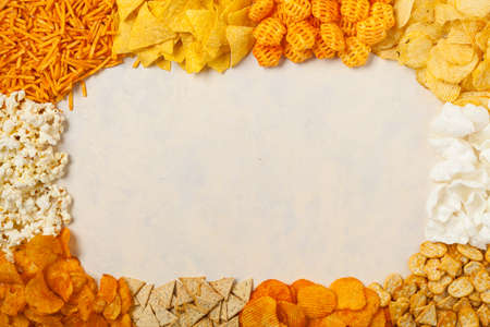 Background made of chips, prays andor popcorn. Top view.
